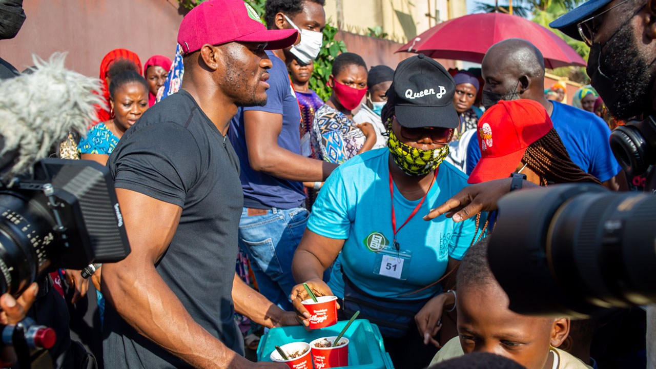 kamaru-usman-feeds-1000-lagos-kids,-pledges-continued-support-for-less-privileged